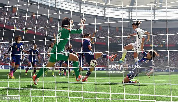 Carli Lloyd of USA scores her second goal despite the efforts of Japan goalkeeper Ayumi Kaihori during the FIFA Women's World Cup 2015 Final between...