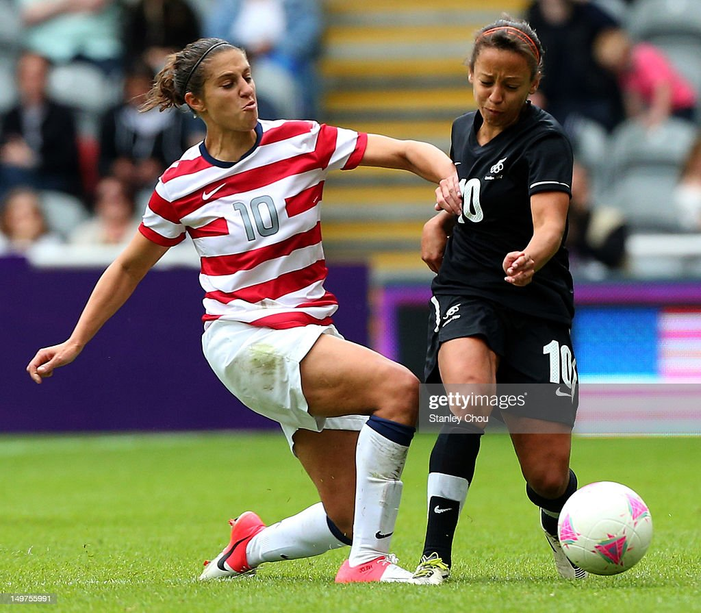 Carli Lloyd of USA tackles Sarah Gregorius of New Zealand during the Women's Football Quarter Final match between United States and New Zealand, on Day 7 of the London 2012 Olympic Games at St James' Park on August 3, 2012 in Newcastle upon Tyne, England.