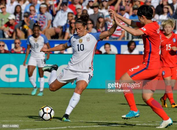 Carli Lloyd of USA takes a shot against Lee Eunmi of Korea Republic during their game at WakeMed Soccer Park on October 22 2017 in Cary North...