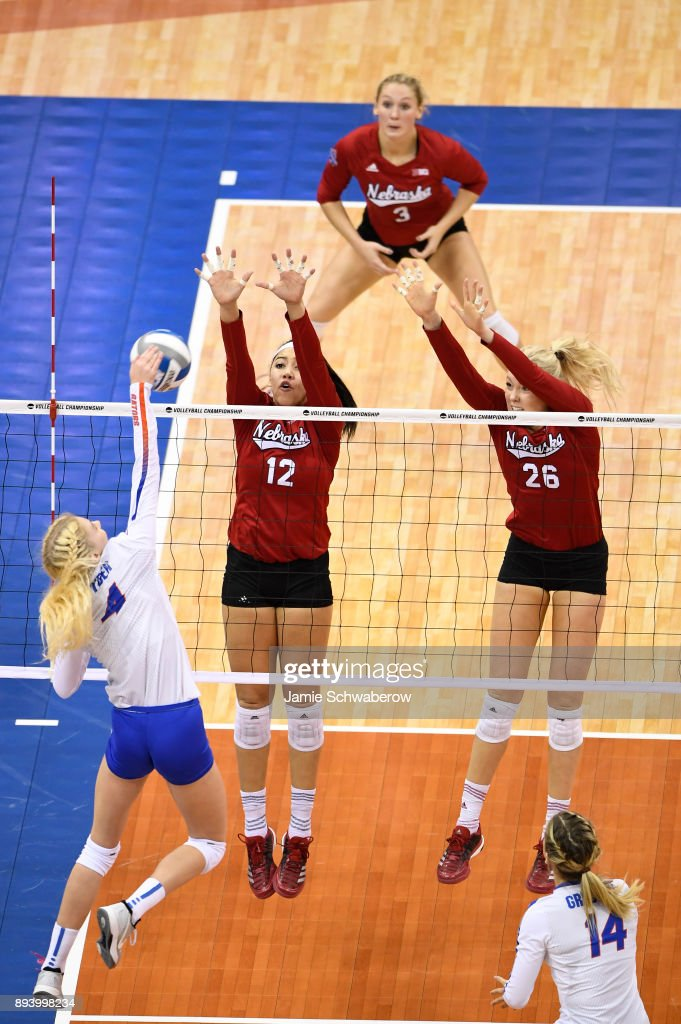 Carli Snyder (4) of the University of Florida attempts a spike past Jazz Sweet (12) and Lauren Stivrins (26) of the University of Nebraska during the Division I Women's Volleyball Championship held at Sprint Center on December 16, 2017 in Kansas City, Missouri.