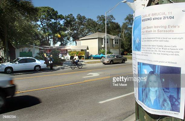 Carlie Brucia's house is seen covered in signs asking for her return February 5 2004 in Sarasota Florida Posters with Carlie's photo on them are up...