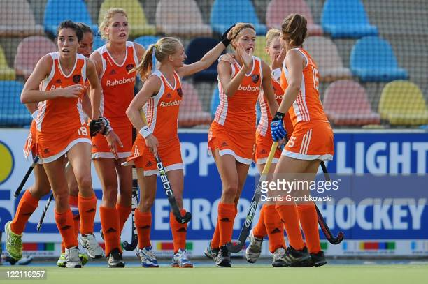 Carlie Dirkse van den Heuvel of Netherlands celebrates with team mates after scoring her team's opening goal during the Women's Eurohockey 2011 semi...
