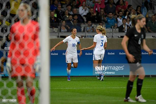 Carlie Lloyd of the United States celebrates her 10 goal with Allie Long against New Zealand during the first half of their first round Rio 2016...