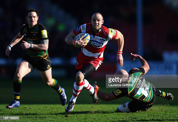 Carlie Sharples of Gloucester breaks past Andy Long of Northampton Saints to score a try during the Aviva Premiership match between Goucester and...