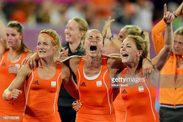 Carlien Dirkse Van Den Heuvel Maartje Paumen and Eva De Goede of Netherlands celebrate their 20 victory over Argentina to win the Women's Hockey gold...