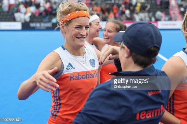 Carlien Dirkse Van Den Heuvel of Netherlands is hugged after the match by Alyson Annan of Netherlands during the Pool A game between Netherlands and...