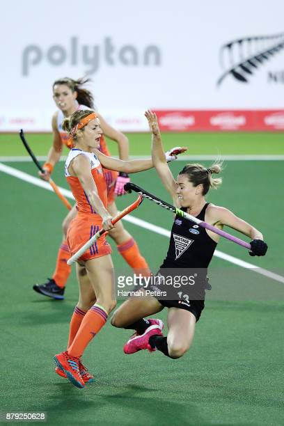 Carlien Dirkse van den Heuvel of New Zealand pushes Samantha Charlton of New Zealand over resulting in a red card during the Hockey World League...