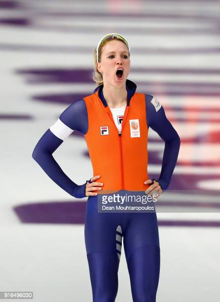 Carlijn Achtereekte of the Netherlands celebrates her time after her race with Karolina Bosiek of Poland during the Women's Speed Skating 3000m on...