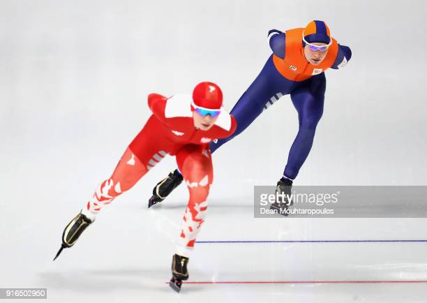 Carlijn Achtereekte of the Netherlands competes against Karolina Bosiek of Poland during the Women's Speed Skating 3000m on day one of the...