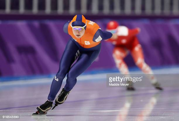 Carlijn Achtereekte of the Netherlands is chased down by Karolina Bosiek of Poland during the Women's Speed Skating 3000m on day one of the...