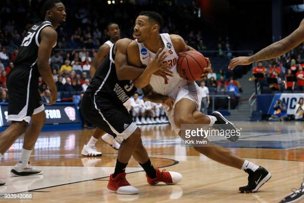 Carlik Jones of the Radford Highlanders drives against Jashaun Agosto of the LIU Brooklyn Blackbirds during the game at UD Arena on March 13 2018 in...
