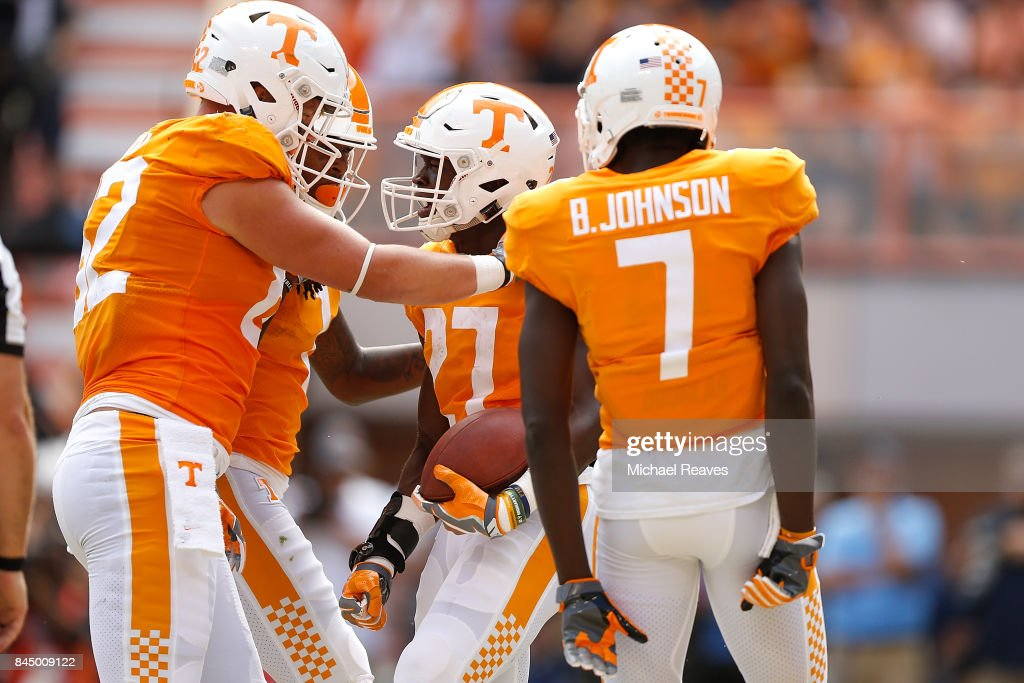 Carlin Fils-Aime #27 of the Tennessee Volunteers celebrates with teammates after scoring a touchdown during the first half of the game against the Indiana State Sycamores at Neyland Stadium on September 9, 2017 in Knoxville, Tennessee.