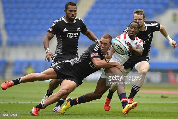 Carlin Isles of the United States gets a pass away during the Gold Coast Sevens round one match between the New Zealand All Blacks and the United...