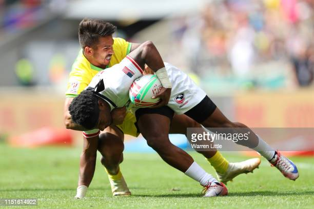 Carlin Isles of United States is tackled by Maurice Longbottom of Australia during the match between USA and Australia during the HSBC London Sevens...