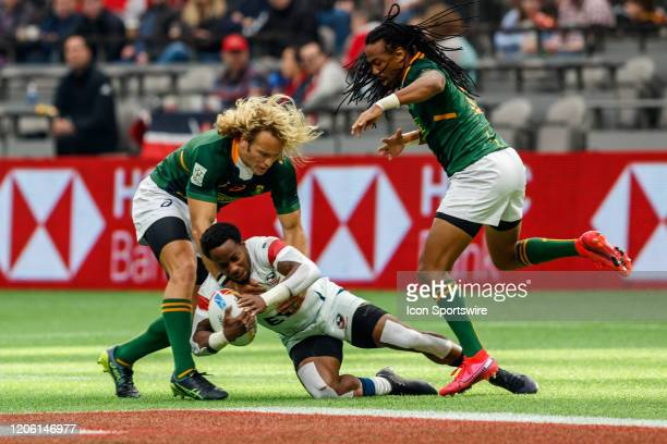 Carlin Isles of USA tackled by Werner Kok and Cecil Afrika of South Africa in Match, South Africa vs USA during the Canada Sevens, Round 6 of the...