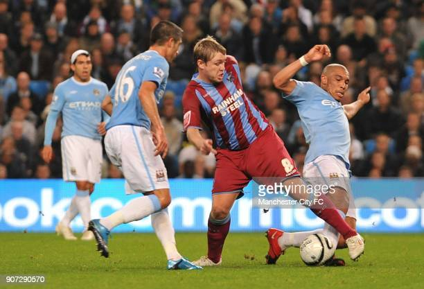 Carling Cup Fourth Round Manchester City v Scunthorpe United City of Manchester Stadium Manchester City's Sylvinho and team mate Nigel De Jong...