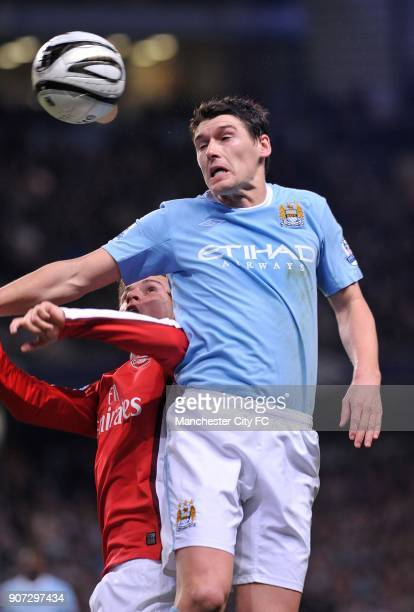 Carling Cup Quarter Final Manchester City v Arsenal City of Manchester Stadium Arsenal's Aaron Ramsey and Manchester City's Gareth Barry battle for...