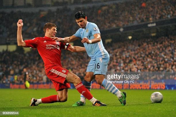 Carling Cup SemiFinal First Leg Manchester City v Liverpool Etihad Stadium Manchester City's Sergio Aguero and Liverpool's Steven Gerrard battle for...