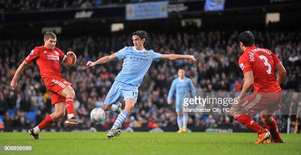 Carling Cup SemiFinal First Leg Manchester City v Liverpool Etihad Stadium Manchester City's Stefan Savic and Liverpool's Steven Gerrard battle for...