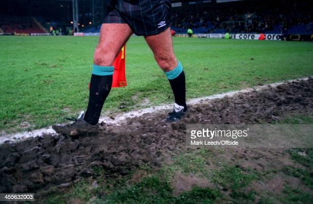 Carling Premiership football Wimbledon v Blackburn Rovers A linesman runs in the muddy furrow along the touchline at Selhurst Park
