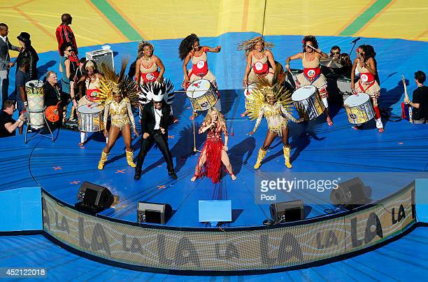 Carlinhos Brown and Shakira perform on stage during the closing ceremony prior to the 2014 FIFA World Cup Brazil Final match between Germany and...
