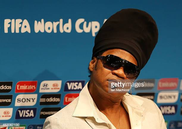 Carlinhos Brown attends a press conference prior to the final match of the 2014 World Cup between Germany and Argentina at The Maracana Stadium on...