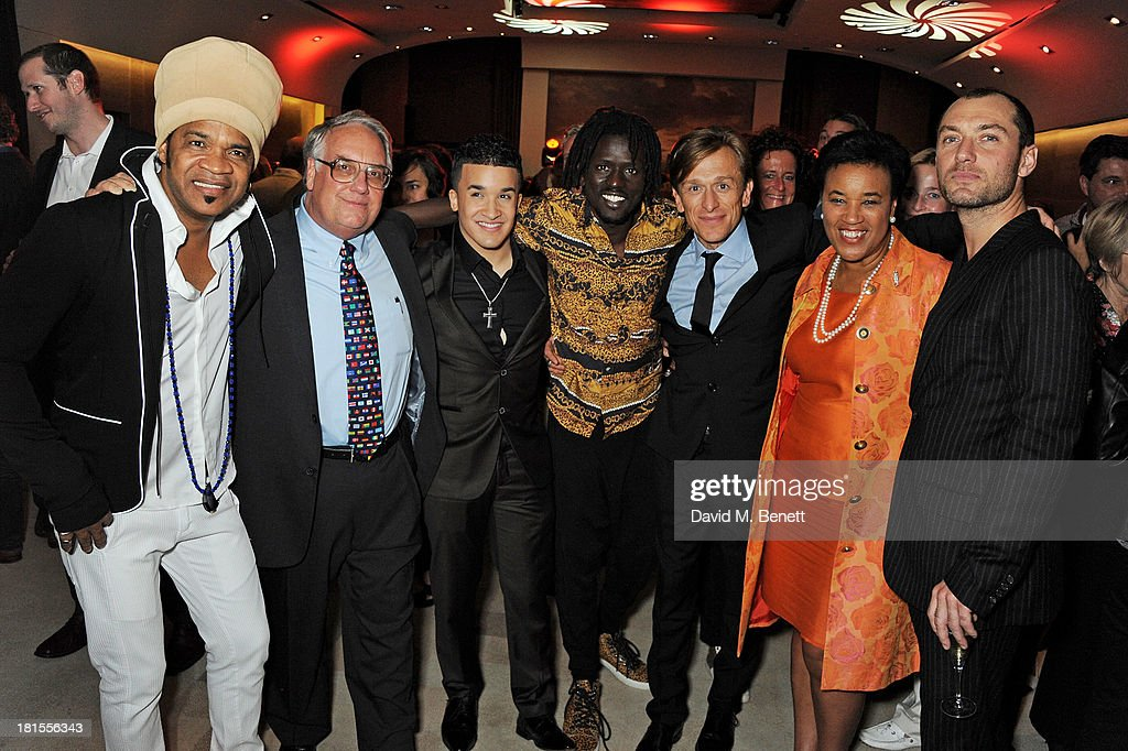 Carlinhos Brown, Howard G Buffett, Jahmene Douglas, Emmanuel Jal, Peace One Day founder Jeremy Gilley, Baroness Patricia Scotland and Jude Law celebrate 'Peace One Day' at the Peace One Day concert after party held at the Hilton on September 21, 2013 in The Hague, Netherlands.