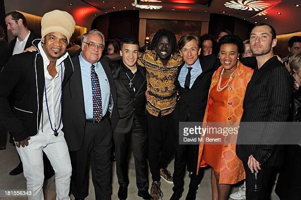 Carlinhos Brown Howard G Buffett Jahmene Douglas Emmanuel Jal Peace One Day founder Jeremy Gilley Baroness Patricia Scotland and Jude Law celebrate...