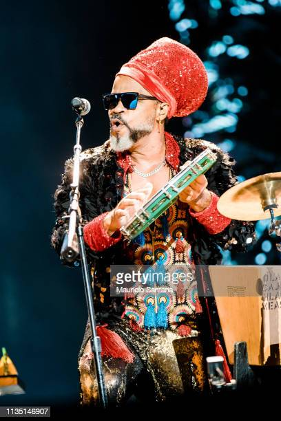 Carlinhos Brown singer member of the band Tribalistas performs live on stage during the first day or day one of Lollapalooza Brazil Music Festival at...