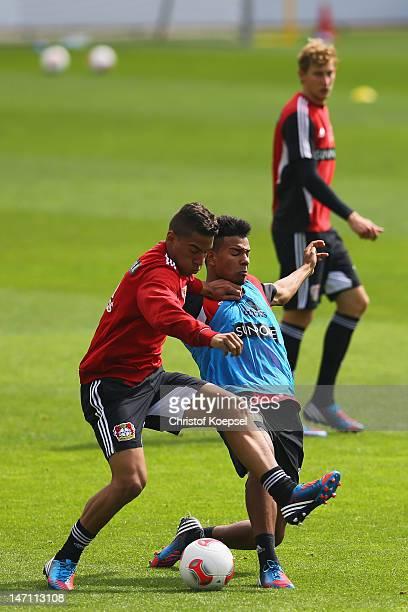 Carlinhos challenges Danny da Costa during the training session of Bayer Leverkusen at Ulrich Haberland Stadium on June 25 2012 in Leverkusen Germany