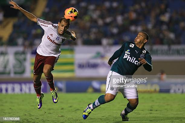 Carlinhos of Fluminense fights for the ball with Walter of Goias during the match between Goias and Fluminense for the Brazilian Series A 2013 at...