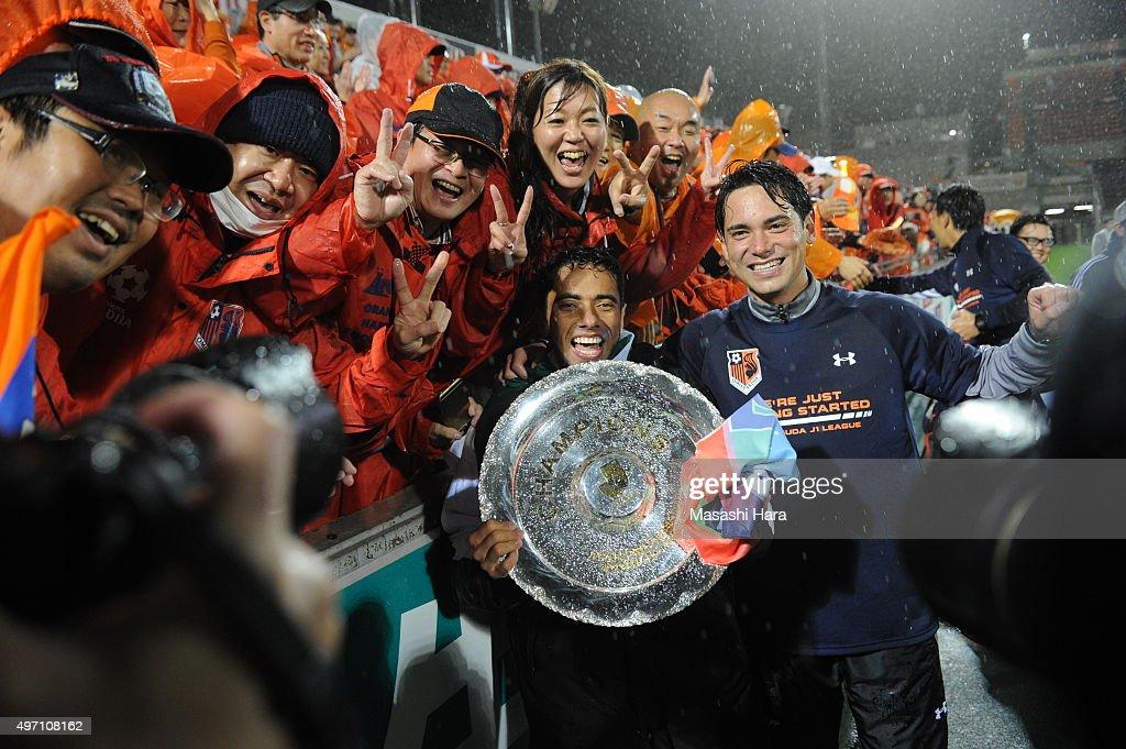 Carlinhos of Omiya Ardija celebrates the victory with supporters after the J.League second division match between Omiya Ardija and Oita Trinita.Omiya won the promotion to the J1 next season.at the Nack 5 Stadium Omiya on November 14, 2015 in Saitama, Tokyo, Japan.
