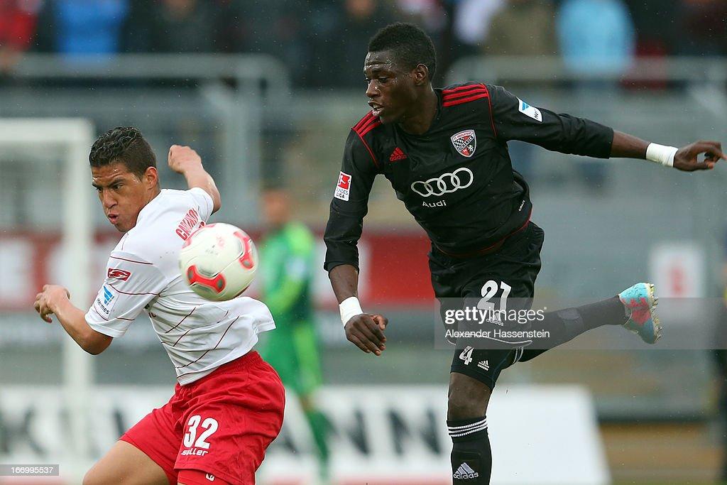 Carlinhos (L) of Regensburg battles for the ball with Danny da Costa of Ingolstadt during the Second Bundesligamatch between Jahn Regensburg and FC Ingolstadt at Jahnstadion on April 19, 2013 in Regensburg, Germany.