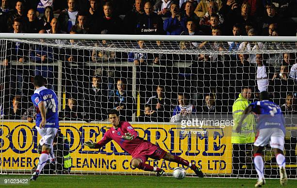Carlisle full back Ian Harte scores from the penalty spot past Portsmouth keeper Asmir Begovic during the Carling Cup 3rd round game between Carlisle...