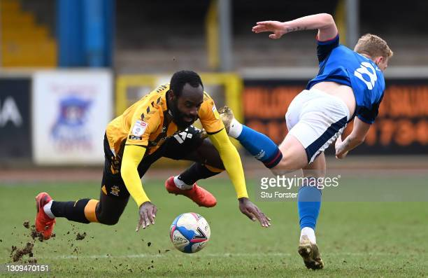 Carlisle player Callum Guy challenges Hiram Boateng of Cambridge during the Sky Bet League Two match between Carlisle United and Cambridge United at...