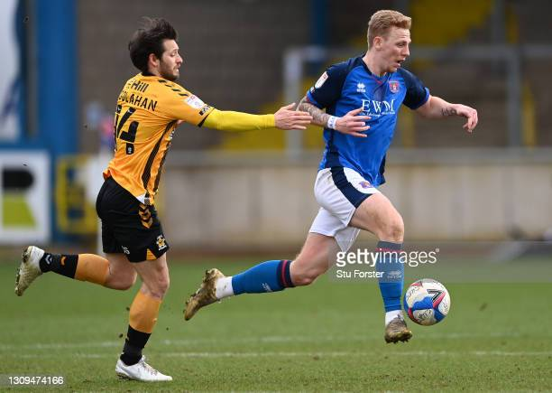 Carlisle player Callum Guy out paces Wes Hoolahan during the Sky Bet League Two match between Carlisle United and Cambridge United at Brunton Park on...