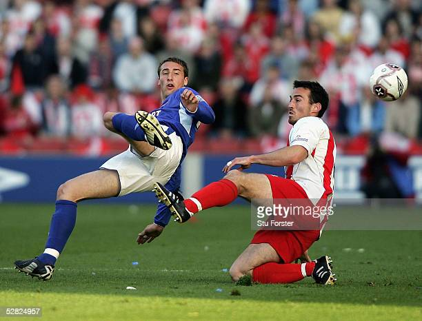 Carlisle player Glenn Murray is challenged by Stevenage defender Barry Laker during the Nationwide Conference play off Final between Stevenage and...