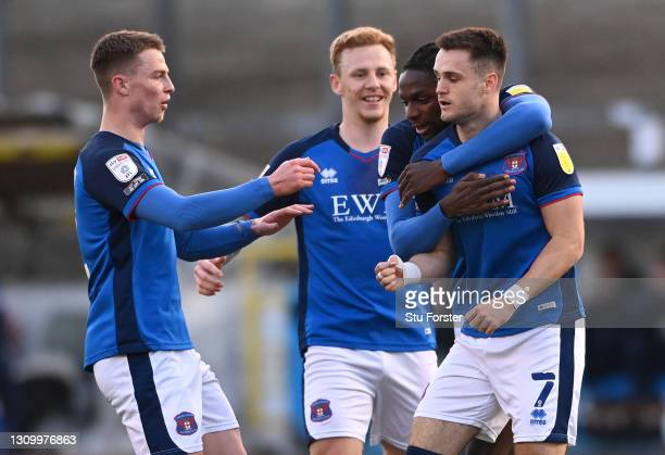 Carlisle player Joe Riley is congratulated after scoring the opening goal during the Sky Bet League Two match between Carlisle United and Crawley...
