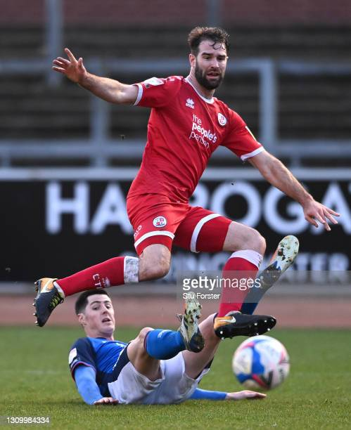 Carlisle player Jon Mellish challenges Crawley player Joe McNerney during the Sky Bet League Two match between Carlisle United and Crawley Town at...