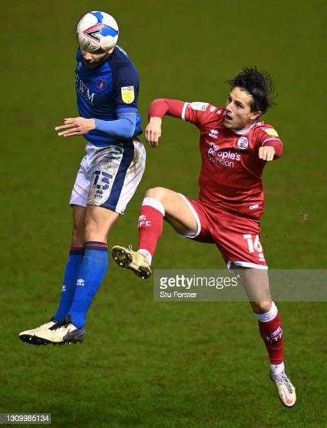 Carlisle player Rod McDonald is challenged by Crawley player Tom Nichols during the Sky Bet League Two match between Carlisle United and Crawley Town...