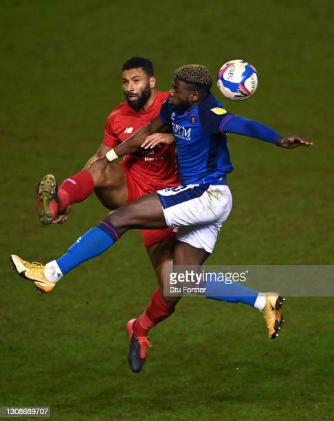 Carlisle striker Offrande Zanzala challenges Jamie Turley of Orient during the Sky Bet League Two match between Carlisle United and Leyton Orient at...