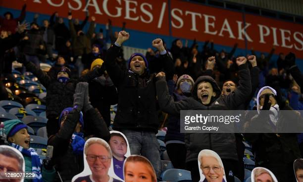 Carlisle United fans social distance in the stand and celebrate their sides first goal scored by Lewis Alessandra during the Sky Bet League Two match...
