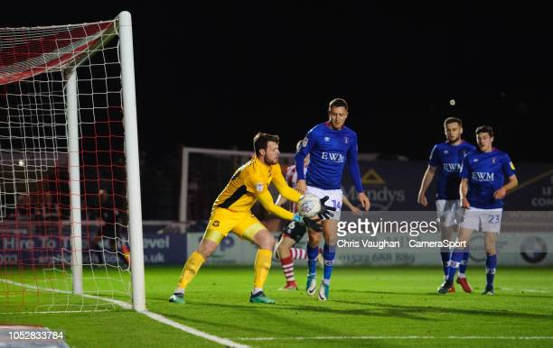 Carlisle United's Adam Collin lets the ball slip through his hands as Lincoln City's Bruno Andrade scores his side's equalising goal to make the...