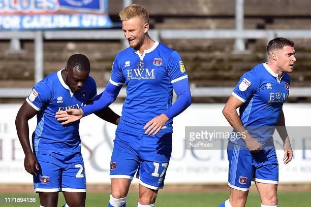 Carlisle's Olufela Olomola celebrates opening the scoring during the Sky Bet League 2 match between Carlisle United and Oldham Athletic at Brunton...