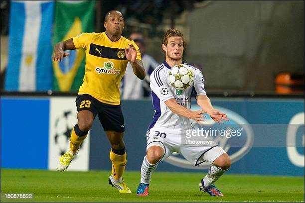 Carlitos of Limassol battles for the ball with Guillaume Gillet of RSC Anderlecht during the third qualifying round of the UEFA Champions League...