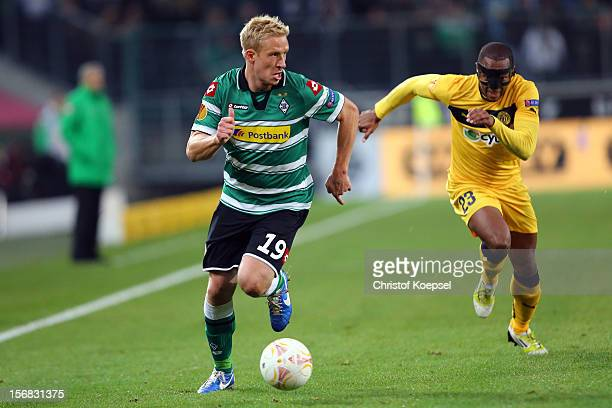 Carlitos of Limassol cchallenges Mike Hanke of Moenchengladbach during the UEFA Europa League group C match between Borussia Moenchengladbach and AEL...