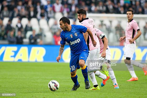Carlitos Tevez and Eros Pisano during the Serie A match betweenJuventus FC and US Palermo at Juventus Stafium on october 26 2014 in Torino Italy
