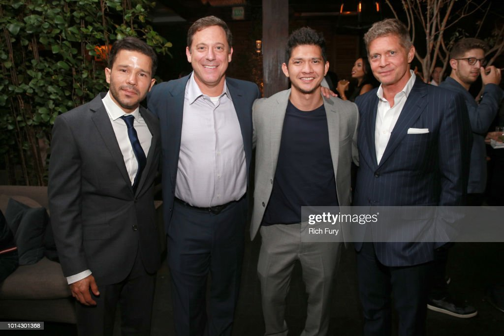 Carlo Alban, Adam Fogelson, Iko Uwais and Bob Simonds attend the after party for the premiere of STX Films' 'Mile 22' at Westwood Village Theatre on August 9, 2018 in Westwood, California.