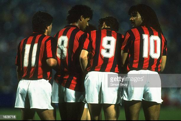 Carlo Ancelloti Frank Rijkaard Marco Van Basten and Ruud Gullit of AC Milan line up in the wall against Real Madrid during the European Cup semifinal...