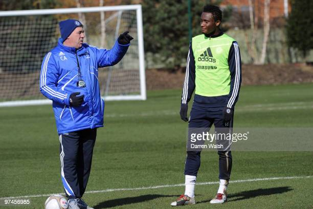 Carlo Ancelotti and John Mikel Obi of Chelsea during a training session at the Cobham Training ground on March 5 2010 in Cobham England